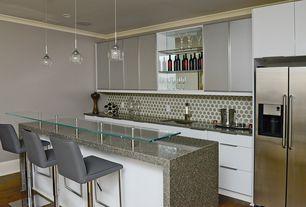 Modern Bar with Crown molding, Pendant light, Hardwood floors, Built-in bookshelf