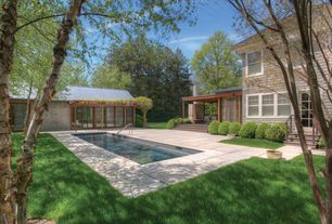 Contemporary Swimming Pool with exterior concrete tile floors, double-hung window, Trellis, Lap pool, French doors