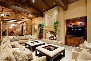 Mediterranean Living Room with Bunny Williams Tray Chic Ottoman, Pendant light, Exposed beam, stone fireplace