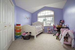 Traditional Kids Bedroom with Standard height, Carpet, Built-in bookshelf, no bedroom feature, Arched window