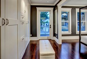 Contemporary Master Bedroom with Hardwood floors, Crown molding, Built-in bookshelf, French doors