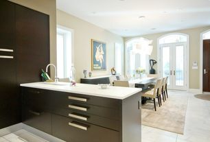 Modern Dining Room with specialty window, can lights, French doors, Concrete tile , specialty door, Standard height