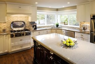 Traditional Kitchen with Traditional cup pull, Flat panel cabinets, Custom hood, Stainless steel counters, L-shaped