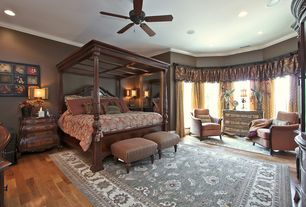Traditional Master Bedroom with Hardwood floors, Crown molding, Built-in bookshelf, Bay window, Ceiling fan