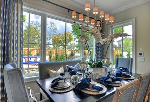 Contemporary Dining Room with Chandelier, Ikat curtain, Woven water hyacinth round metallic placemat, Hardwood floors
