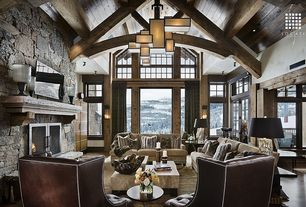 Rustic Living Room with Cathedral ceiling, stone fireplace, Transom window, flush light, Exposed beam, Hardwood floors