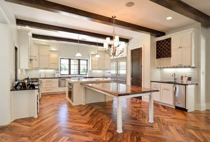Traditional Kitchen with Wood counters, Corian counters, Kitchen island, U-shaped, specialty door, Glass panel, Chevron
