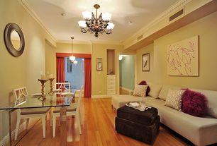 Modern Dining Room with Crown molding, Standard height, Built-in bookshelf, can lights, Chandelier, Hardwood floors