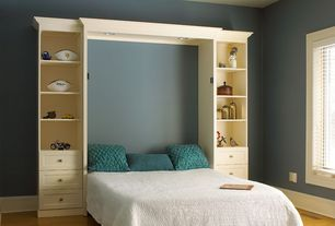 Traditional Guest Bedroom with Built-in bookshelf, Laminate floors, Standard height, can lights, Paint, Ceiling fan