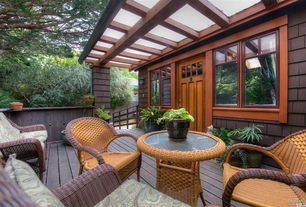 Craftsman Deck with Columns, High ceiling, Hardwood floors, Glass panel door