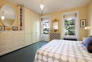 Traditional Guest Bedroom with double-hung window, Hardwood floors, Built-in bookshelf, Standard height, Chandelier