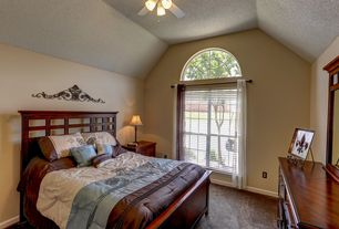 Mediterranean Guest Bedroom with double-hung window, Carpet, Ceiling fan, Arched window, Standard height