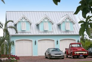 Traditional Garage with specialty door, Brick floors, Paint, High ceiling, Wall sconce