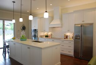 Contemporary Kitchen with double wall oven, Subway Tile, Indirect above cabinet lighting, Standard height, Pendant light