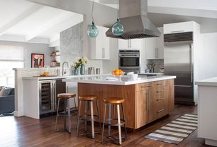 Contemporary Kitchen with Kitchen island, Wine refrigerator, Glass jug pendant, U-shaped, Exposed beam, Ceramic Tile, Flush