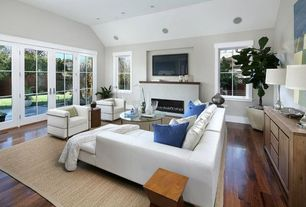 Contemporary Living Room with Built-in bookshelf, French doors, Hardwood floors, Cement fireplace