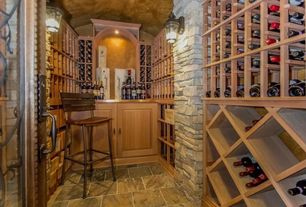 Traditional Wine Cellar with Built-in bookshelf, Wall sconce, French doors, slate floors