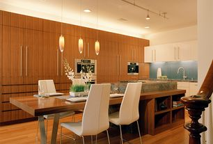 Contemporary Kitchen with European Cabinets, Onyx counters, Breakfast nook, Kitchen island, Standard height, Pendant light