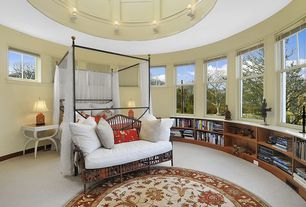 Traditional Master Bedroom with Built-in bookshelf, Carpet, Wall sconce, High ceiling