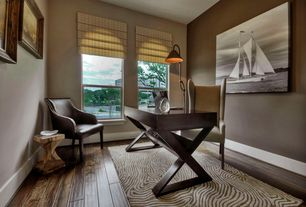Contemporary Home Office with Hardwood floors