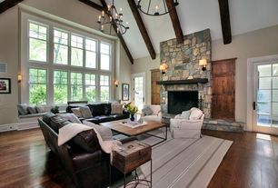 Living Room with Hardwood floors, Cabot round chandelier, Chandelier, Cathedral ceiling, Exposed beam, French doors