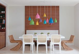 Contemporary Dining Room with Built-in bookshelf, Concrete floors, Standard height, Pendant light