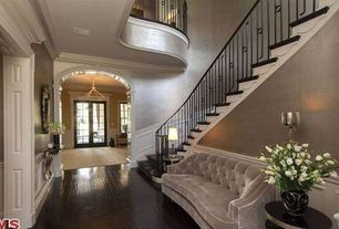 Traditional Entryway with Hardwood floors, Crown molding, Chandelier, Wainscotting, Balcony, French doors, Standard height