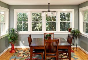 Traditional Dining Room with Chandelier, Hardwood floors