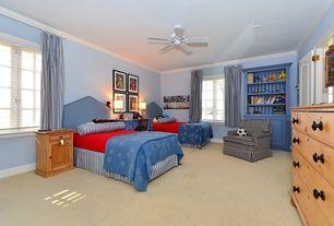 Traditional Kids Bedroom with Ceiling fan, Crown molding, specialty door, Built-in bookshelf, Carpet