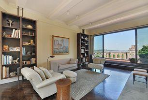 Modern Living Room with Exposed beam, Laminate floors, Built-in bookshelf
