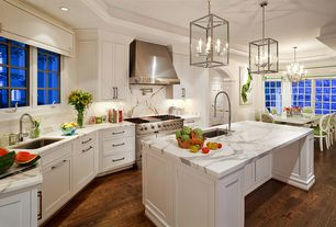 Traditional Kitchen with Flat panel cabinets, French doors, Crown molding, Chandelier, Complex marble counters, One-wall