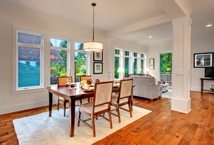 Traditional Dining Room with Crown molding, Hardwood floors, Columns, Pendant light