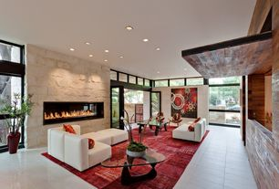 Contemporary Living Room with Transom window, Fireplace, stone tile floors, French doors, picture window, specialty window