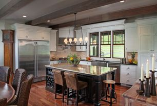 Craftsman Kitchen with Breakfast bar, Stone Tile, Complex granite counters, Farmhouse sink, Soapstone counters, Exposed beam