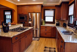 Kitchen with European Cabinets, Flush, Crown molding, MS International Granite Giallo Ornamental, Flat panel cabinets