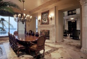 Mediterranean Dining Room with Helena marble mantel - medium, Wall sconce, can lights, Standard height, stone tile floors