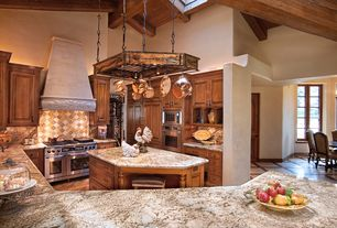 Mediterranean Kitchen with Undermount sink, Paint, Complex granite counters, Inset cabinets, wall oven, built-in microwave