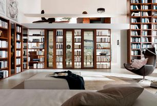 Contemporary Living Room with High ceiling, Built-in bookshelf, Artifort boson chair by patrick norguet, Concrete floors