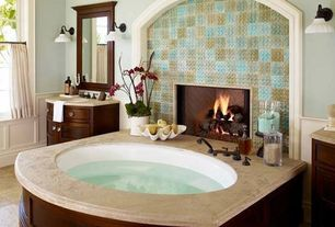 Traditional Master Bathroom with Standard height, drop in bathtub, Fireplace, Limestone counters, Wall Tiles, Bathtub