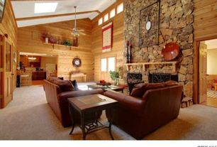 Rustic Living Room with High ceiling, French doors, Skylight, Exposed beam, stone fireplace, Carpet, Built-in bookshelf