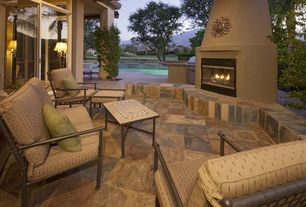 Eclectic Patio with outdoor pizza oven, Transom window, exterior stone floors, Outdoor kitchen