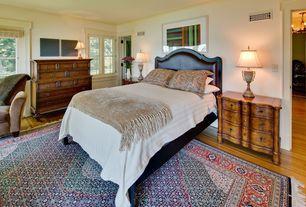 Eclectic Guest Bedroom with Laminate floors, Crown molding, Hardwood floors