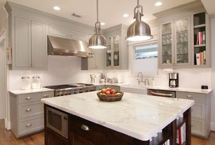 Traditional Kitchen with Flat panel cabinets, Complex marble counters, Inset cabinets, Subway Tile, Hardwood floors, Casement