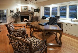 Traditional Home Office with Hardwood floors, Fireplace, French doors, Cement fireplace, can lights, Built-in bookshelf