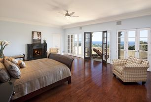 Modern Guest Bedroom with brick fireplace, Crown molding, French doors, Laminate floors, Ceiling fan, Paint 1, Fireplace