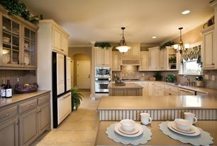 Traditional Kitchen with Glass panel, Formica counters, Stone Tile, Casement, Breakfast bar, full backsplash, Raised panel