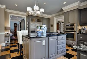 Contemporary Kitchen with Breakfast bar, electric cooktop, Complex granite counters, Crown molding, Flat panel cabinets