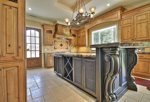Mediterranean Kitchen with Kitchen island, Custom hood, Bay window, Crown molding, U-shaped, Complex granite counters
