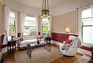 Traditional Living Room with Chair rail, Pendant light, interior wallpaper, Hardwood floors, High ceiling