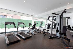Modern Home Gym with Yowza fitness captiva elliptical, Concrete floors, Schwinn 270 Recumbent Exercise Bike